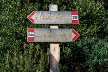 The direction sign at the crossroads of trails near Corniglia, Cinque Terre, Italy